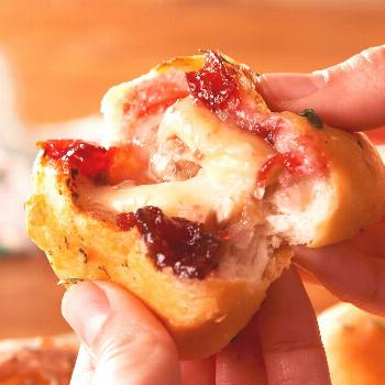 Stuffing crescent roll with brie and cranberry sauce is life changing. Get the recipe at .