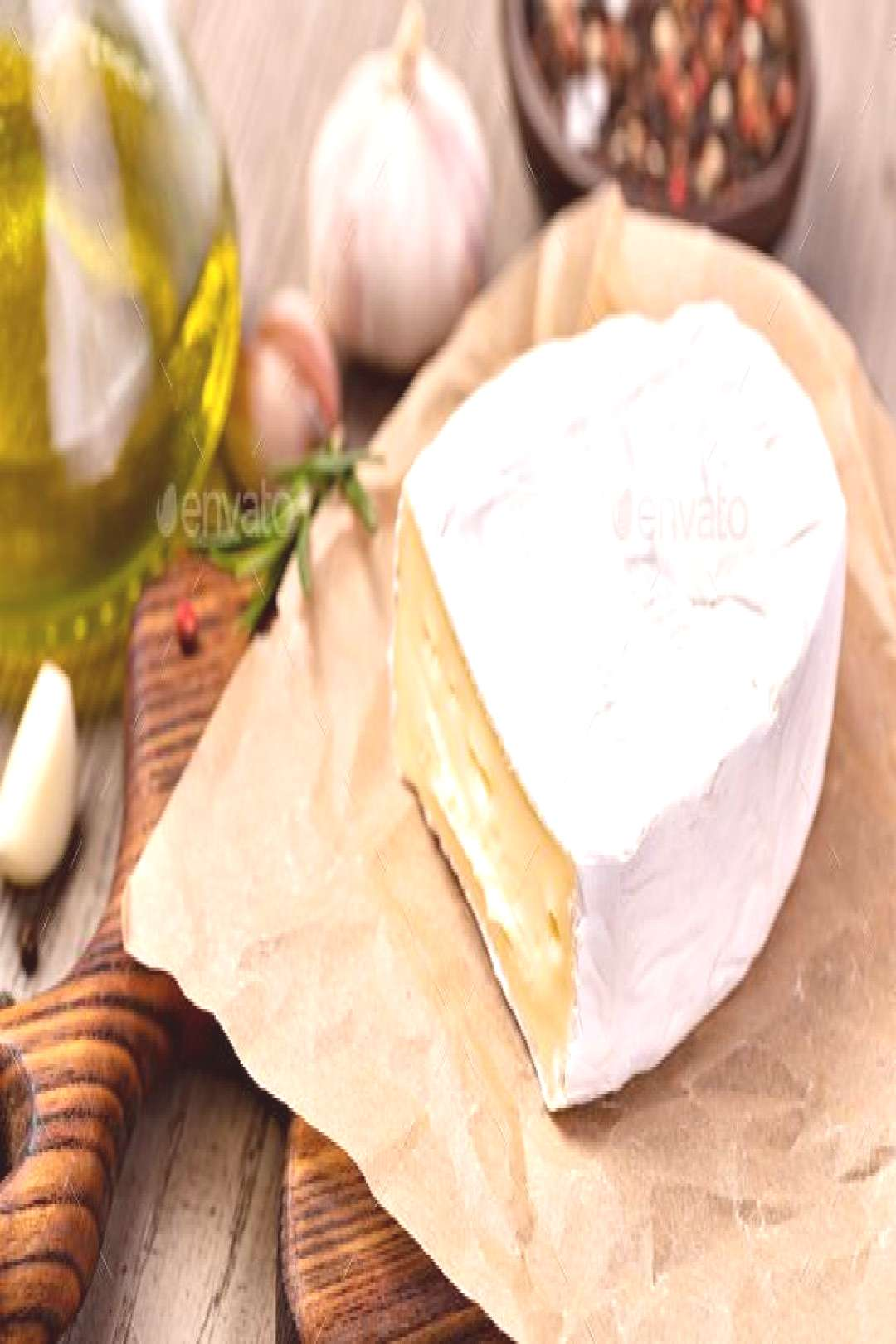 Brie Cheese by gresei. Brie Cheese on wooden background